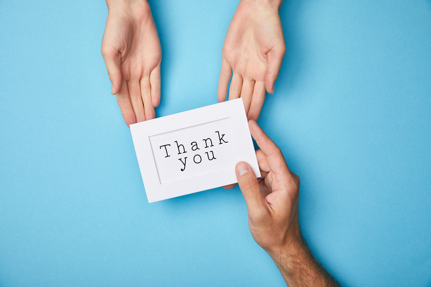 hands holding thank you sign